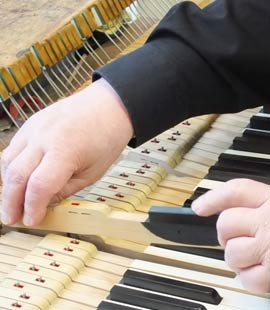 a piano key being replaced