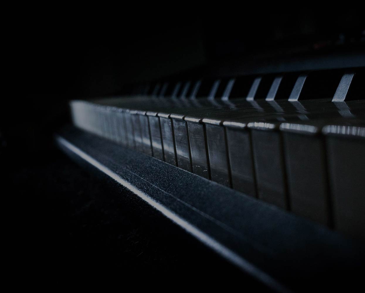 background of a close up of some piano keys