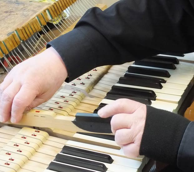 key being replaced inside a piano