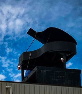 piano moved on top of building